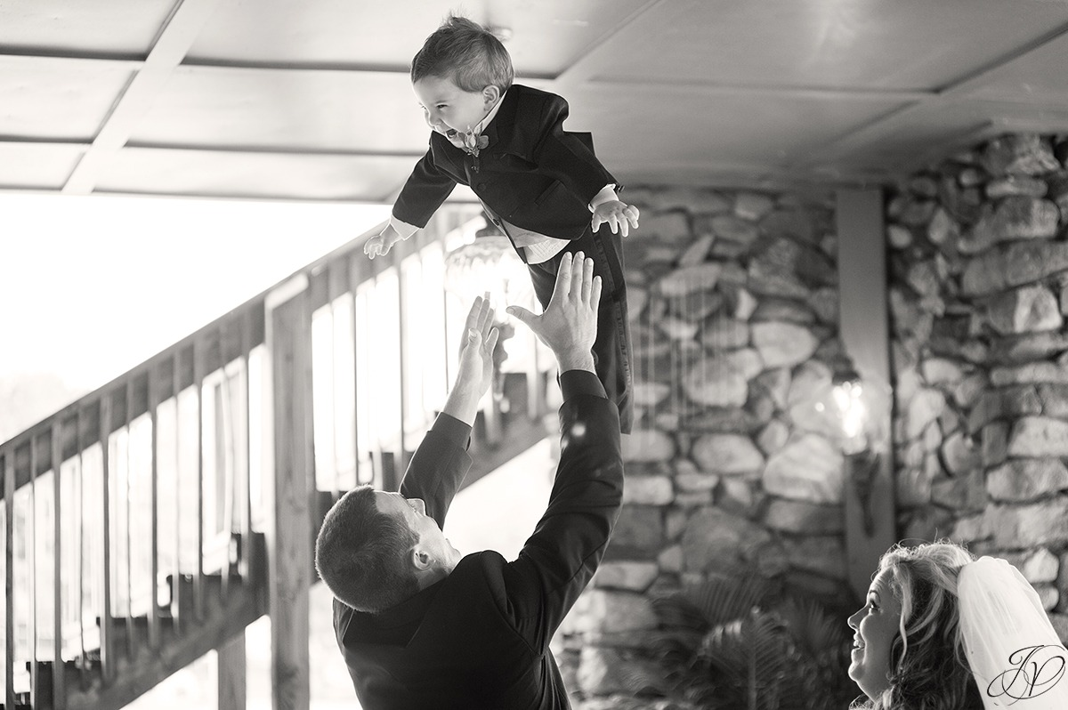 cute photo of son being thrown in the air
