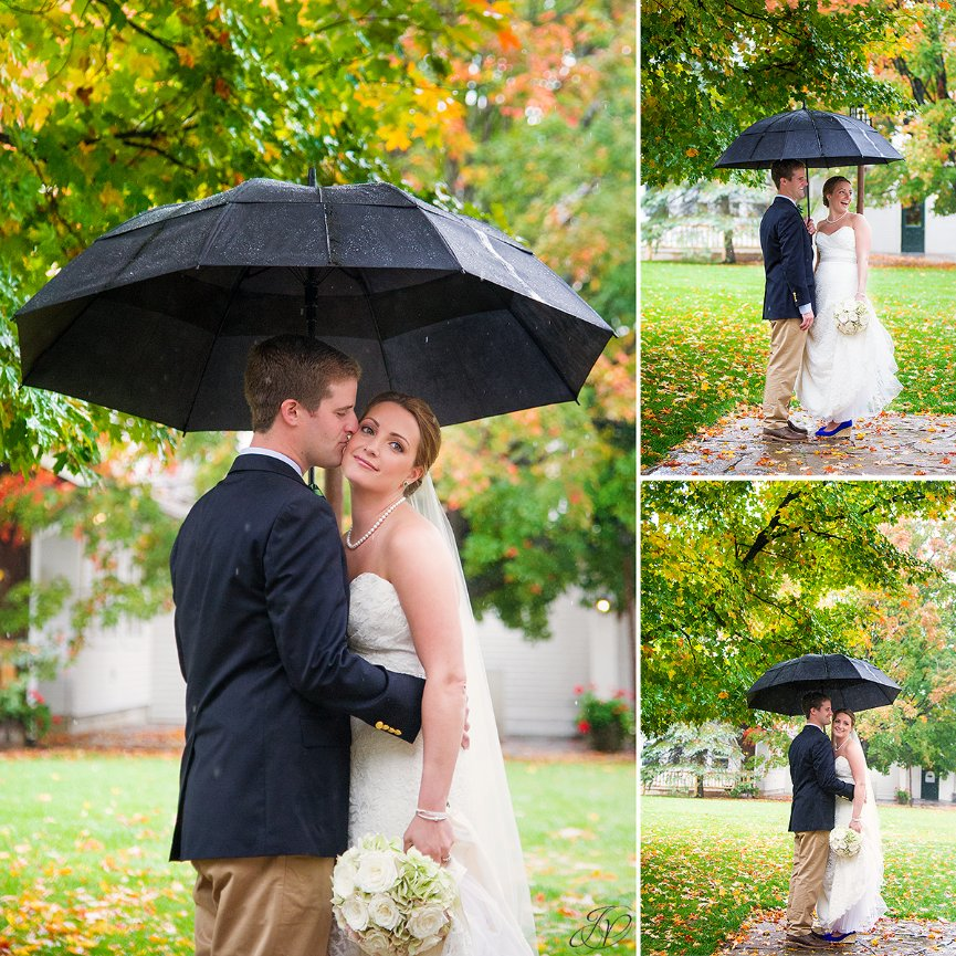 fun photo of bride and groom in the rain