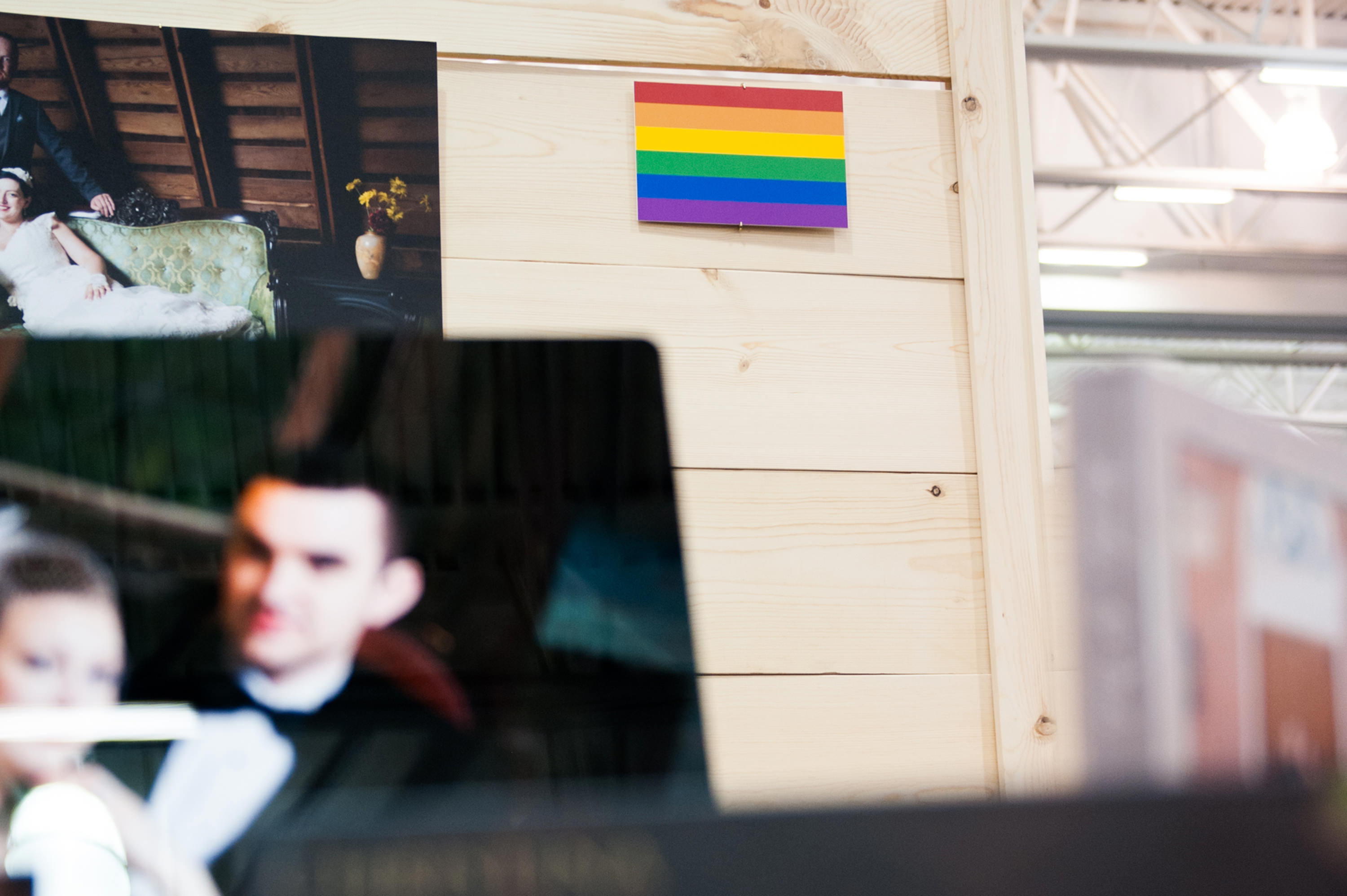 Firelily Photography Madison, WI 2017 Winter Bridal Show Booth | Same-Sex Wedding Photography: Rainbow flag: Love is love is love is love