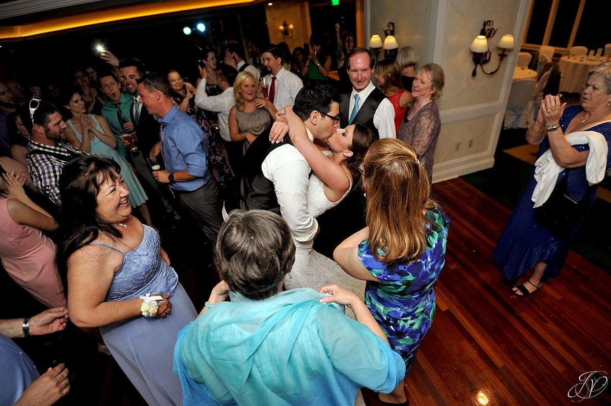 groom dips bride during wedding reception