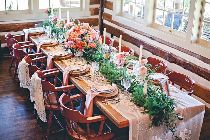 A Full View Of The Table With Mixed Foliage Garland Plumosa Fern And Italian Ruscus Cascading Off Ends
