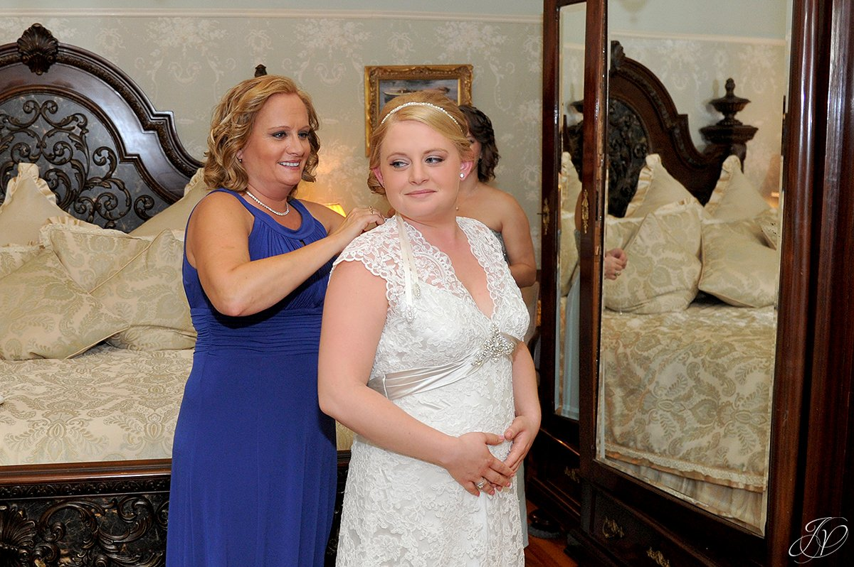 bride getting wedding prep help from mother