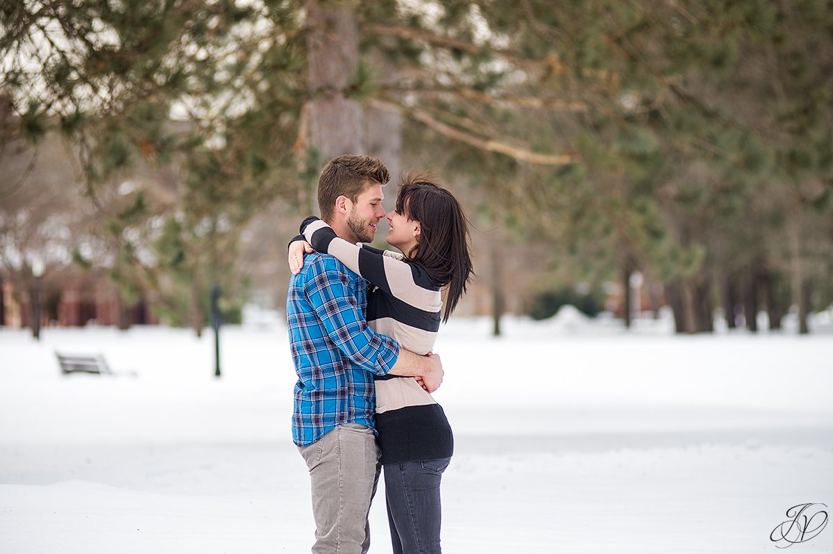 photo of engaged couple almost kissing
