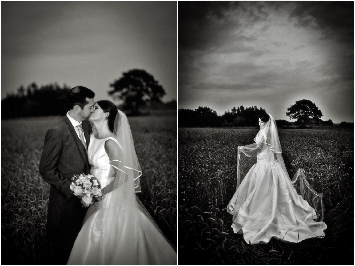 Black and white photograph of wedding couple in field