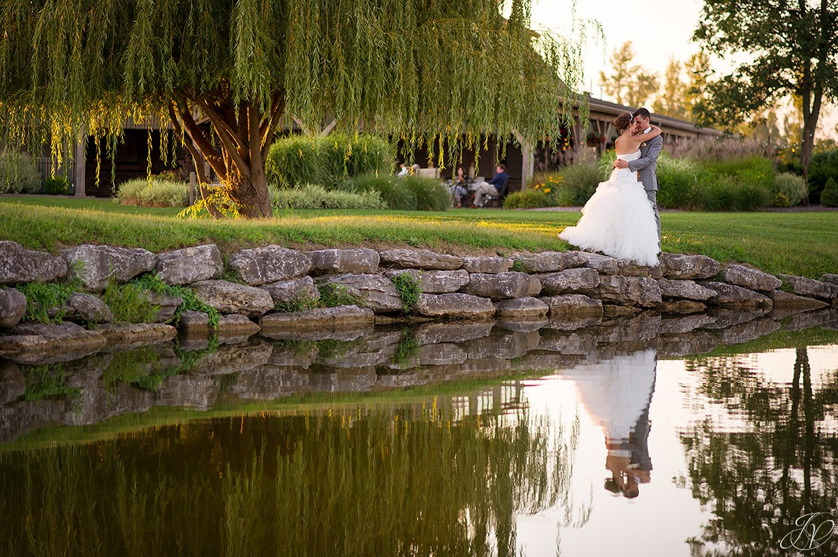 sunset bride and groom Arrowhead Golf Club water reflection