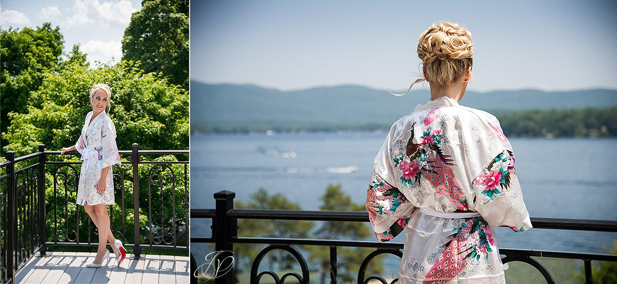 bride in getting ready robe looking out over Lake George