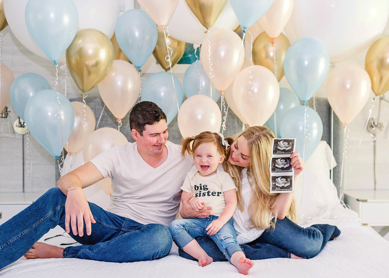 cute pregnancy announcement, blue balloons, peach balloons, gold balloons, Rya Duncklee