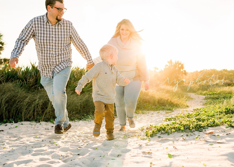 mom and dad running with boy on beach, Saint Augustine Beach, Florida, Ryaphotos