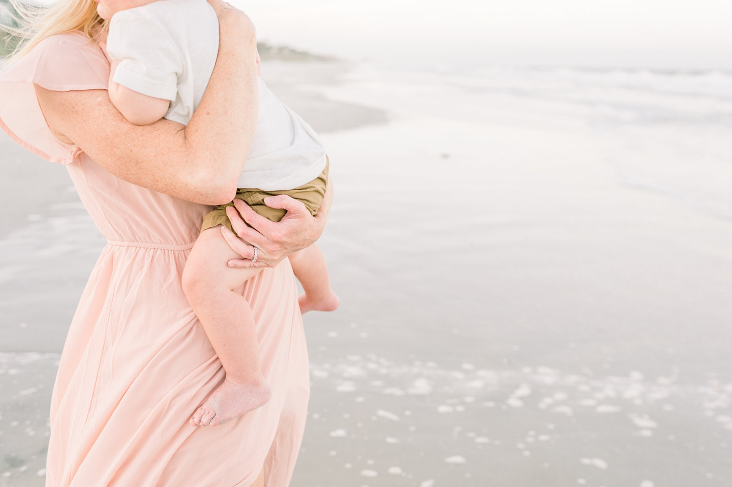 mother with freckled arms holding baby son, Ponte Vedra Beach, Rya Duncklee