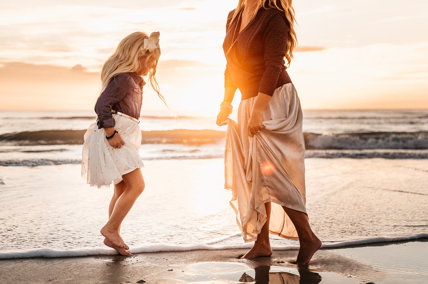 mother and daughter in the surf of Saint Augustine Beach, Florida