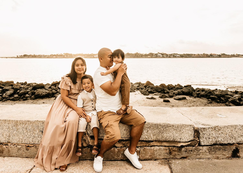 beautiful family of four portrait along the St. Augustine, Florida coast, Ryaphotos